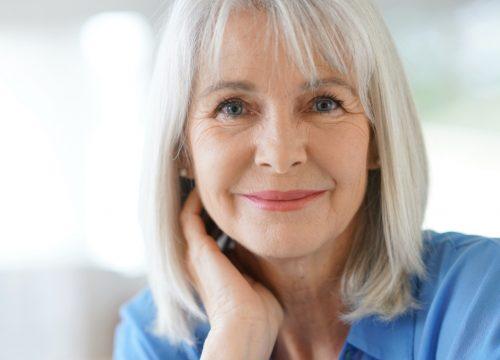 An older woman before a bone density scan