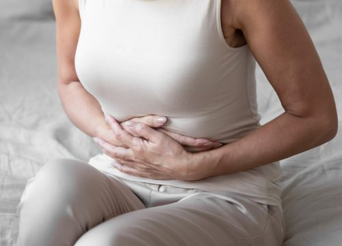 Woman suffering from inflammatory bowel disease