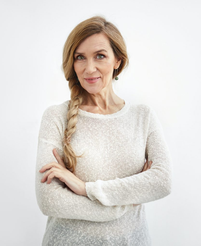 Older woman in a white sweater