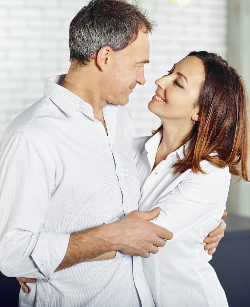 Happy couple after woman's vaginal laxity treatments