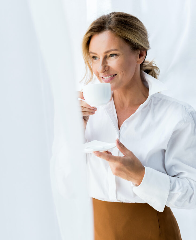 Woman sipping a cup of coffee at home